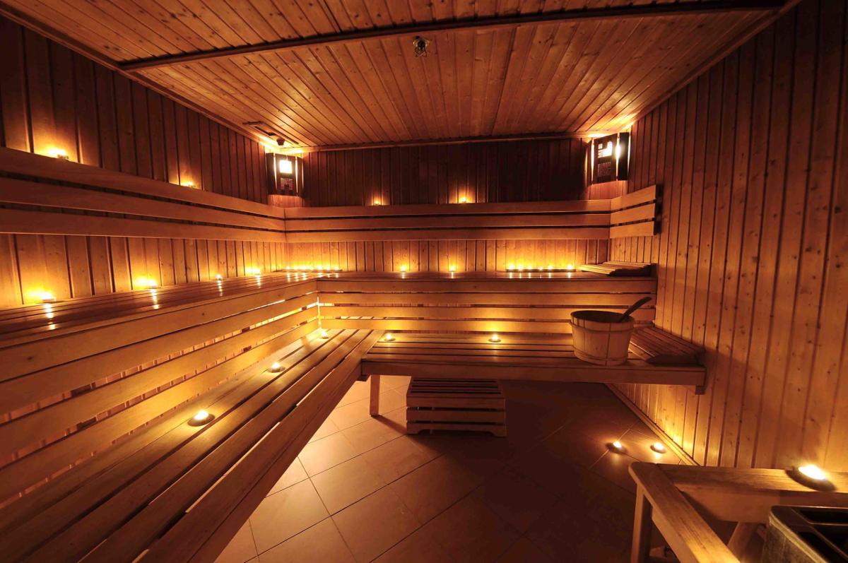 Warm finnish sauna interior with candles